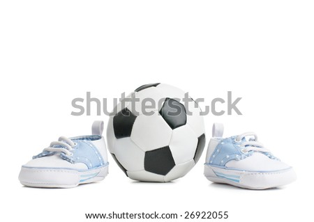 A football / soccer ball with baby shoes, on white.