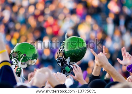 A football Victory with Green Helmet - stock photo