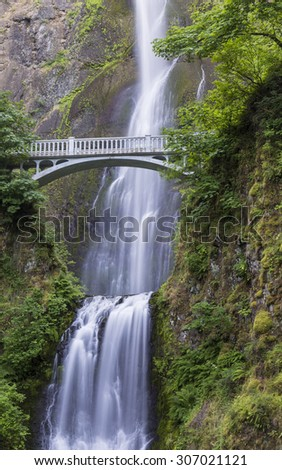 A footbridge arches over Multnomah Falls, on of the tallest waterfalls in the U.S., near Portland, Oregon
