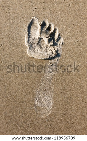 A footprint in the sand on coast of the Mediterranean sea - Israel - stock photo