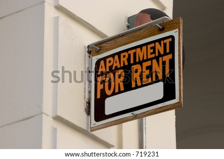 A for rent sign on display on the side of a down town apartment building. - stock photo