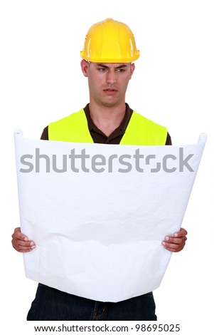 A foreman going over his plans. - stock photo