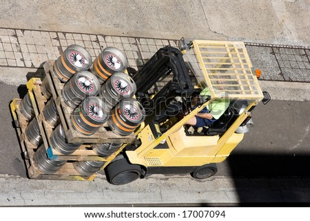 A fork lift with loaded crate - stock photo