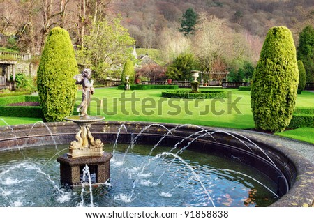 A formal fountain and garden at Rydal Hall, Rydal, Cumbria, a tranquil Christian retreat and holiday destination - stock photo
