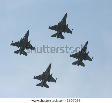 A formation of 4 F-16 jet fighters