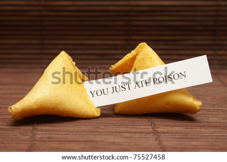 A fortune cookie tells the fate for the unlucky person who just ate his last meal. - stock photo