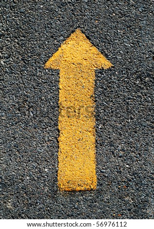 A forwarded yellow arrow on the road - stock photo