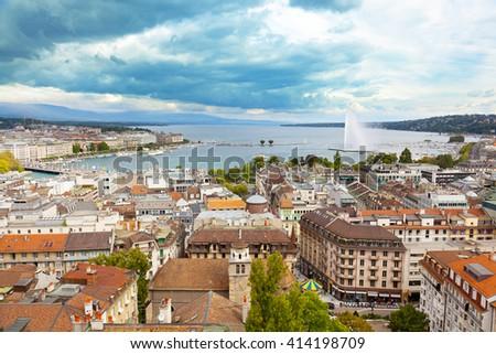 A fountain Jet dEau rises over the waterfront of Lake Geneva, Geneva, Switzerland - stock photo