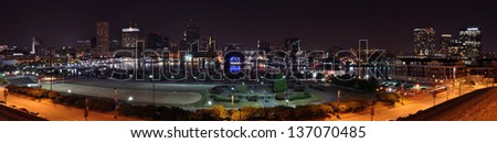 A four segment panorama of Baltimore's Inner Harbor skyline taken at night from Federal Hill. - stock photo