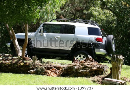A four wheel drive vehicle going off-road - stock photo