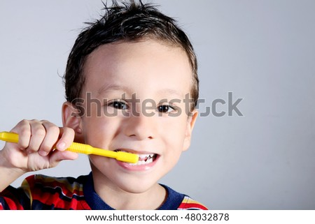 A four year old child brushing his teeth. Oral care