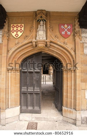 A Fourteenth Century Carved Stone Doorway with Coats of Arms and Bishop Statue