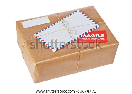 A fragile parcel wrapped in brown paper and tied with rough twine, isolated on white background. Shallow depth of field