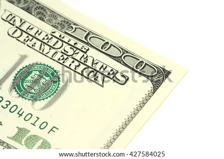 a fragment of a denomination in hundred American dollars on a white background