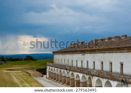 A fragment of a fortified historical Medieval Almeida village in Portugal. The fortress around the town guards an important cross-border road from Spain, and underwent several sieges - stock photo