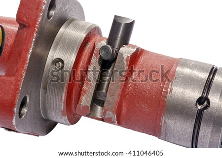 a fragment of a fuel pump in the center of the frame, the part regulating the engine speed, closeup, on white background