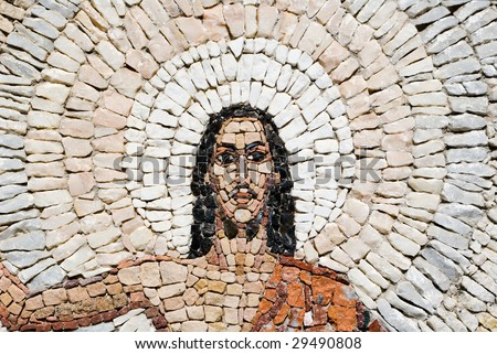 a fragment of a stone mosaic  of Jesus Christ resurrection - stock photo