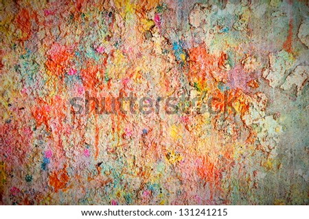 A fragment of the old wall texture covered in paint - stock photo