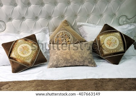 a fragment of the sofa with pillows, pattern - stock photo