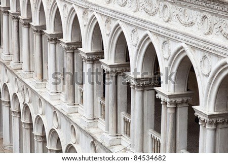 A frame filling pattern of arches from the inner façade of the Doge's Palace in Venice. - stock photo