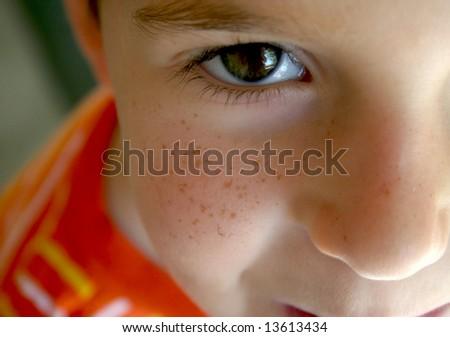 a freckle faced boy close up - stock photo