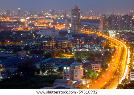 a freeway at dusk heading to the center of bangkok thailand