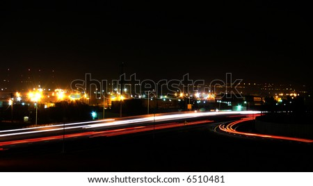 A freeway photographed at night