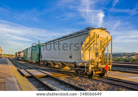 A Freight Train at Sunset - stock photo