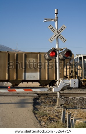 A freight train passes by at a grade crossing - stock photo