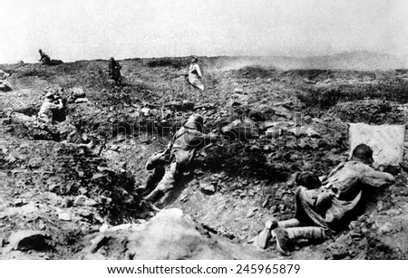 A French assault on German positions (in foreground trench). As the moving attackers, the French troops are very vulnerable to shots from the entrenched Germans. Champagne, France. WWI. 1917. - stock photo