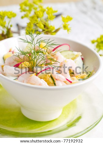 A fresh and light salad with shrimps. Shallow depth of field, selective focus - stock photo
