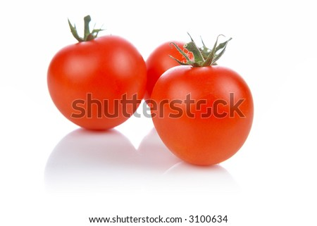 A fresh and tasty tomatoes reflected on white background. Shallow DOF - stock photo