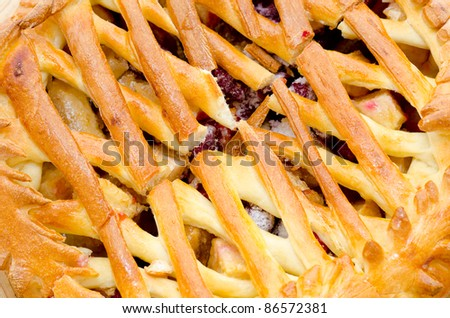 a fresh apple and strawberry pie - a closeup shot - stock photo