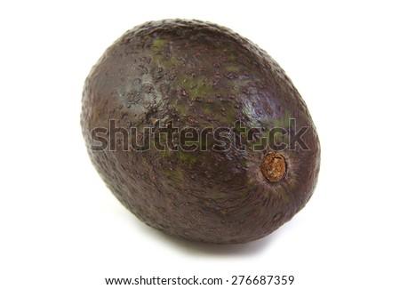 A fresh avocado on white background - stock photo