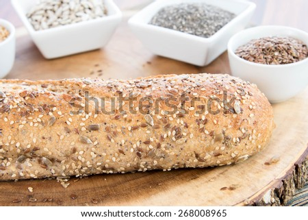 a fresh baked loaf of whole grains bread with poppy, flax adn sunflower seeds - stock photo