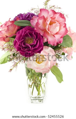 A fresh cut bouquet of colorful spring roses from a home garden, vertical with white background and copy space - stock photo