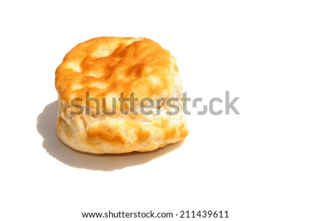 A  Fresh from the Oven Piping Hot Golden Brown Flour Biscuit isolated on white with room for your text. Flour Biscuits are eaten around the world by hungry people, with Fried Chicken, Gravy and more. - stock photo