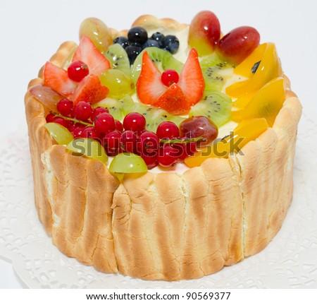 a fresh fruit and berry cake - a closeup shot - stock photo
