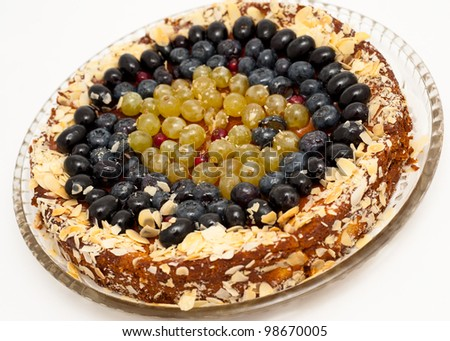 a fresh grape cheesecake - sprinkled with almond - stock photo