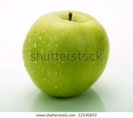 A fresh green apple with water drops - stock photo