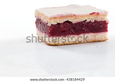 A fresh icing cake with cherry gelantine, isolated on a white background