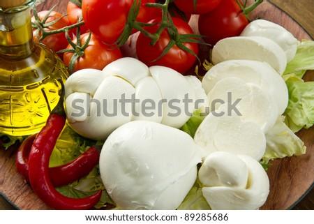 a fresh italian mozzarella  with tomato - stock photo