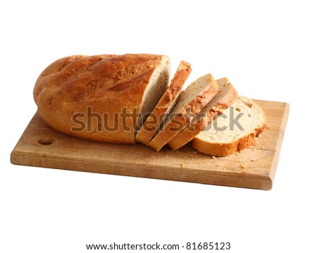A fresh loaf of rye bread. Sliced and on a cutting board isolated on white. - stock photo