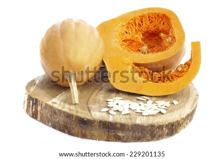 A fresh pumpkin isolated on white and wood background - stock photo