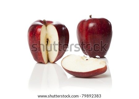 A fresh red apple with a slice cut out