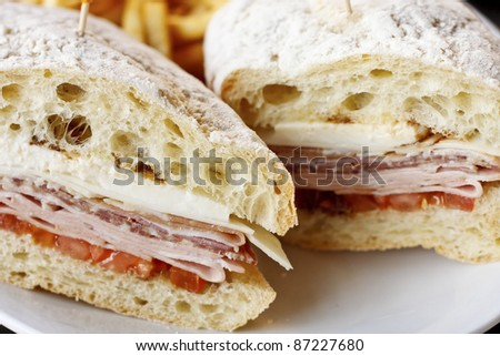 A fresh sandwich of cold cuts and cheese on fresh baked bread - stock photo