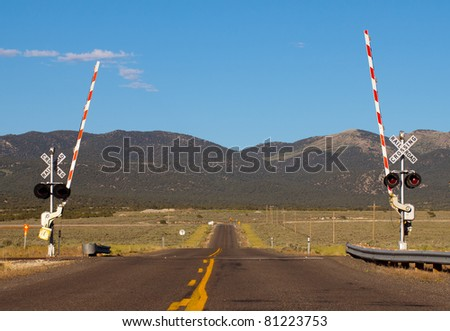 A fresh, sharp and detailed image of a railroad crossing. - stock photo