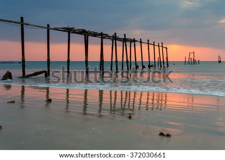 A fresh sunset with the sun hidden behind the clouds during low tide on Pilai beach in Phang Nga province in Thailand - stock photo
