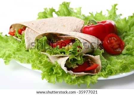 a fresh tortilla with peper and salad - stock photo