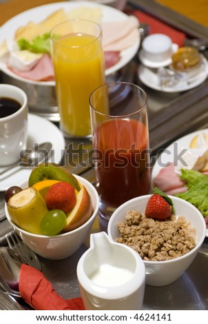 A fresh tray of fruits and meats for breakfast - stock photo